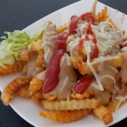 Fenelon Poutine Recipe - Try poutine, Fenelon Falls-style. Here's an English-Canadian version, using shredded cheese instead of cheese curds, with gravy, lettuce, mayonnaise, and ketchup.