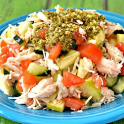 Seedless Summer Salad Recipe - Apple, cucumber and tomato are mixed with tuna in a basil pesto sauce. Serve as a side dish or a light lunch.