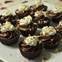 Hazelnut Cups Recipe - Bonbon cups act as molds for individual chocolate shells that are then filled with a creamy chocolate-hazelnut center. Foil or paper bonbon cups (like mini muffin liners) are available at craft stores and kitchen supply stores.