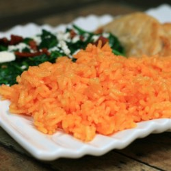 Yellow Rice for Rice Cookers Recipe - Use this recipe for yellow rice made in a rice cooker as a base for adding vegetables or meat for a flavorful and easy side dish.
