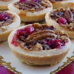 Pecan Cranberry Butter Tarts Recipe - Pecan and cranberry butter tarts are a festive dessert to serve on Thanksgiving and during the holidays and will disappear quickly.