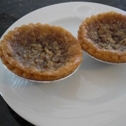 Best Raisin Currant Butter Tarts Recipe - This recipe makes a big batch of the biggest, best raisin and currant-filled butter tarts. Homemade pastry, fitted into muffin pans, forms the tart shells.