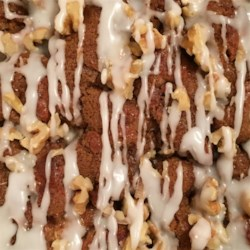 Herman Coffee Cake Recipe - A cinnamon-pecan sourdough coffee cake with brown sugar and raisins is finished with a brown sugar glaze, resulting in a scrumptious breakfast delight.