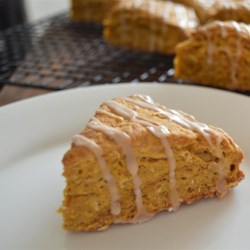Pumpkin-Oat Scones Recipe - These iced scones with oats and pumpkin puree are seasoned with cinnamon, nutmeg, ginger, and cloves.