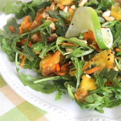 Mango, Carrot, and Arugula Salad Recipe - Mangoes, arugula, and carrots are tossed in a tangy, lime dressing for a colorful and fresh lunch or dinner salad.