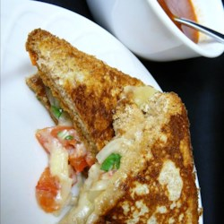 Pico De Gallo Grilled Cheese Sandwich Recipe - Grilled cheese with a layer of pico de gallo makes for a tasty Mexican-inspired lunch. Serve with tomato soup.