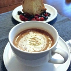 Coconut Hot Cocoa Recipe - This homemade hot chocolate is made with coconut milk and cocoa with hints of vanilla and cinnamon; perfect to warm you up on a cold day.