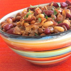 Mother Earth's Baked Beans Recipe - Baked beans loaded with bacon, ground beef, and plenty of spices and seasonings are simmered in the slow cooker for hours for a hearty side dish. For best flavor, refrigerate cooked beans overnight and reheat the next day.