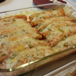 Enchanted Sour Cream Chicken Enchiladas Recipe - Sour cream and chicken fill these quick and easy enchiladas.