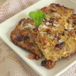 Bed and Breakfast Baked Oatmeal  Recipe - Bake oatmeal in a mixture of milk and egg with cranberries, coconut, and chopped nuts for a new breakfast item your family will love.