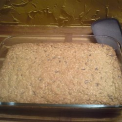Amazing Oatmeal Chocolate Chip Bars Recipe - These gooey cookie bars are made with quick-cooking oats and lots of chocolate chips. A package of pudding mix adds to their moist texture.