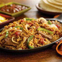 Beef and Bell Pepper Fajitas Recipe - Make fajitas heartier by adding Zatarain's Spanish Rice to the filling of sautéed beef, bell peppers and onions. It's a quick and easy dinner idea for the whole family.