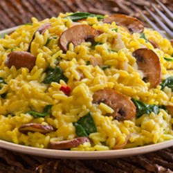 Creamy Spinach & Mushroom Risotto Recipe - This creamy and savory risotto can go with almost any dish. Start with Zatarain's Yellow Rice and add mushroom, spinach, onion, heavy cream and Monterey Jack cheese for a side that will get as much attention as the main dish.