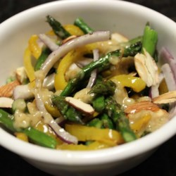 Roasted Asparagus and Yellow Pepper Salad Recipe - Roasted asparagus and yellow peppers are tossed with a tangy dressing.