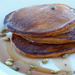Double Pumpkin Pancake Recipe - Pumpkin puree and toasted pumpkin seeds are a tasty duo in these double pumpkin pancakes; serve with maple syrup and butter.