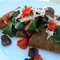 Savory French Crepes  Recipe - At 611 Supreme in Seattle, authentic French crepes are filled with either savory or sweet fillings. In this recipe, a buckwheat crepe is filled with mushrooms, tomatoes, spinach, and Gruyere cheese.