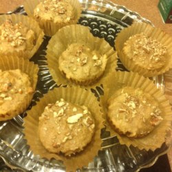 Applesauce Muffins Recipe - Applesauce and honey give these walnut and raisin muffins a sweetness without the added sugar.