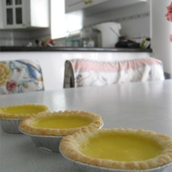 Hong Kong Style Egg Tarts Recipe - Very easy to make Chinese style Egg Tart, you can put the leftovers in the refrigerator for later use for up to 3 days. You can reduce the sugar used on the crust and the filling to fit your taste, this recipe is lightly sweetened. If you want to you, can add more sugar to the filling. Hope you enjoy it!