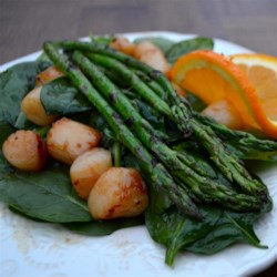 Seared Scallop and Asparagus Salad Recipe - Asparagus spears and scallops are given a quick sear, then placed on a spinach salad with a homemade balsamic vinaigrette in this quick and elegant recipe.
