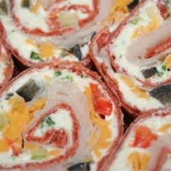 Party Pinwheels Recipe and Video - It's easy to make lots and lots of these cream-cheese-based rounds: Simply use extra-large tortillas and roll them up with the smooth and crunchy filling.
