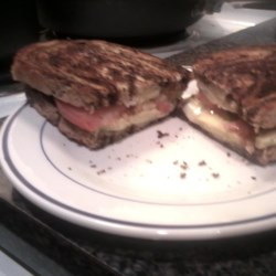 Alexa's Gourmet Grilled Cheese Recipe - Avocado, tomato slices, and Swiss cheese are cooked between marbled rye bread for a gourmet grilled cheese sandwich.