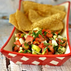 Apple Tomato Salsa Recipe - Roast garlic, tomatoes, apples, and jicama together with herbs and lime on the stove top and you have this quick-and-easy apple tomato salsa.