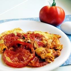 Eggs with Tomatoes Recipe - Fried eggs and tomatoes in a tomato sauce - a delightful brunch!
