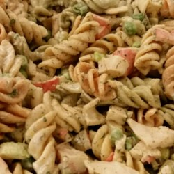 Easy Crab Pasta Salad Recipe - Imitation crab meat dresses up a simple pasta salad with peas, water chestnuts, chives, and dill.