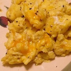 Curry Cheddar Scrambled Eggs Recipe - The best, creamiest scrambled eggs are flavored with curry and Cheddar cheese.  Try these once and you'll be hooked!