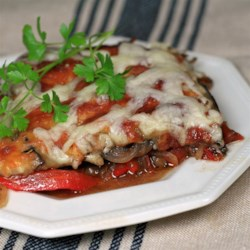 Eggplant and Red Pepper Bake Recipe - This recipe is for an herb-accented baked dish with eggplant, red bell pepper, and onion, topped with cheese.