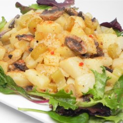 Potatoes and Onions Recipe - Mushrooms, onions and celery are cooked in a fat-free vinaigrette until the dressing is absorbed and the vegetables tender. This yummy concoction is then spooned over warm, cubed, cooked potatoes. Delicious.