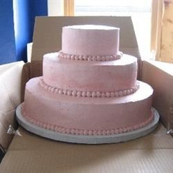 Boxing up cake for transport: cut one side of the box so that you can easily slide the cake in.
