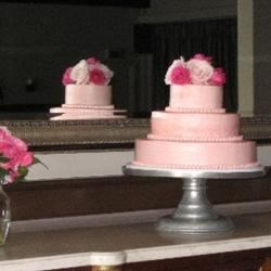 Pink wedding cake! On a stand & garnished with roses at the reception site.