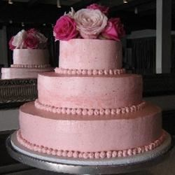 Almond cake with raspberry curd and raspberry cream fillings, finished with raspberry buttercream.