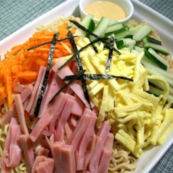 Hiyashi Chuka Noodles Recipe - Ramen noodles are served cold with chili sauce, cucumber, and carrot slices as well as ham and egg. This is a common cold noodle salad in Japan, and always great to eat when the weather is hot.