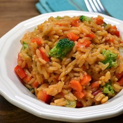 Yellow Rice with Vegetables Recipe - Try this recipe for Spanish yellow rice with fresh veggies for a side dish that everyone will love.