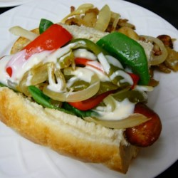 Buffalo Chicken Sausage and Pepper Sandwich Recipe - Sliced sausages, onion, and bell pepper get pan-fried and mixed with blue cheese dressing and hot sauce to deliver a sandwich reminiscent of Buffalo-style chicken wings.