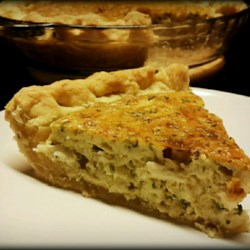 Crab and Cheddar Quiche Recipe - Make this easy and rich crab and Cheddar cheese quiche with a prepared pie crust for a special brunch treat.