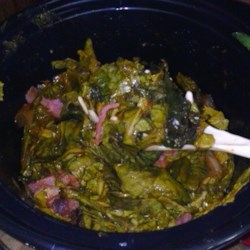 Deborah's Slow-Cooker Collard Greens Recipe - Collard, mustard, and turnip greens come together in this slow-cooked side dish. Diced ham and beef broth add smoky richness to the vegetables.