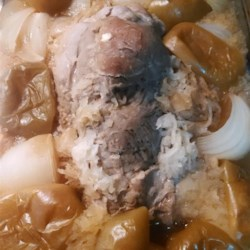Pork Roast with Apples, Beer, and Sauerkraut Recipe - Surround a pork loin roast with sauerkraut, apples, and onions, and pour a can of beer on top before roasting for hours. The basics of this recipe couldn't be simpler.