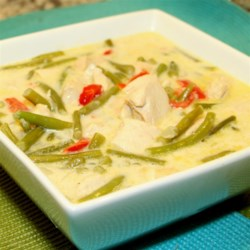 Coconut Chicken with Green Beans Recipe - Green beans and chicken are simmered in coconut milk for a fairly quick and simple tasty meal.