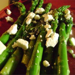 Minted Lemon Asparagus Recipe - An easy spring side dish that doesn't mask the asparagus's unique flavor, and is done in just 3 easy steps.  Top with feta cheese for extra tang, or use slivered almonds for a milder flavor and a little crunch.  Serve hot or cold.