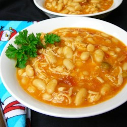 White Chili VI Recipe - Chunks of white meat chicken, Great Northern beans, salsa, and Pepper Jack cheese make this a super simple and super quick recipe sure to please everyone! Serve with tortilla chips and sour cream.