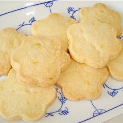 Almond Shortbread II Recipe - Quick, easy almond shortbread cookies that can be prepared ahead of time and taken from the fridge to bake in only 15 minutes.  Melt in the mouth.  You can decorate the shortbread with almond slivers instead of whole almonds, if you like.