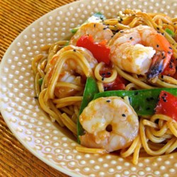 Spicy Thai Shrimp Pasta Recipe - Thin rice noodles, peanut sauce, and plenty of shrimp make this Asian style dish a perfect cold accompaniment for grilled foods - or try it warm as an entree!