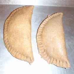 Empanadas I Recipe - You have a choice of two fillings: a spicy, cooked fruit filling or a savory meat filling. Either can be tucked inside rounds of pastry that are sealed into tight packets and baked in the oven. They make a great picnic treat or a delicious, casual supper.