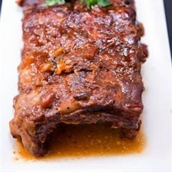 Hawaiian Spareribs Recipe - Baked pork spareribs take a tasty, tropical turn with this rich recipe that features crushed pineapple in the sauce. It goes great with mashed potatoes.