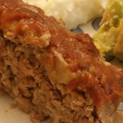 Barbeque Ranch Meatloaf Recipe - Baby carrots and tender fingerling potatoes surround a juicy meatloaf made of ground sirloin and pork sausage and flavored with ranch dressing.