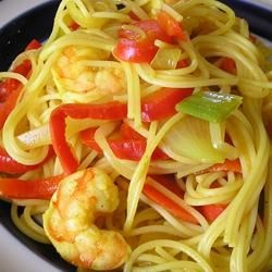 Singapore Noodles Recipe - Here is a somewhat spicy curry dish of vermicelli noodles with a medley of veggies and shrimp, chicken, and pork. It's an Asian way to  clear out the fridge.