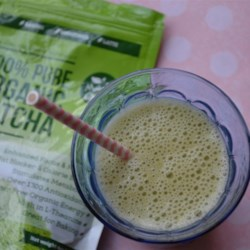 Matcha Smoothie Recipe - Matcha green tea powder gives this mango and orange smoothie a bright green color for a refreshing way to start the day.